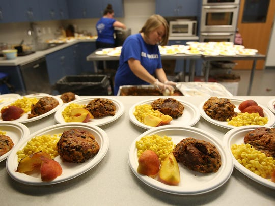Elizabeth Fromherz prepares meals at the Boys and Girls Club on Tuesday, July 14, 2015, in Salem.