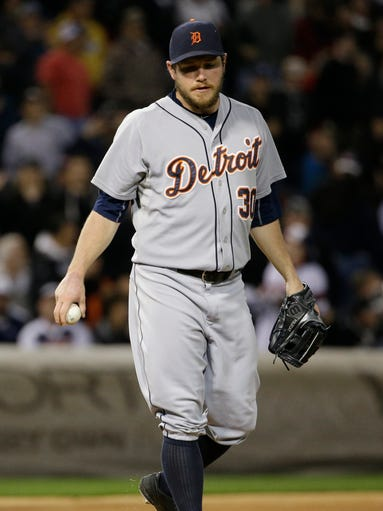Detroit Tigers relief pitcher Alex Wilson looks down