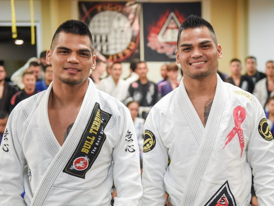 Brothers Elijah Reyes, left, and Luis Reyes stand before their Tuesday night class at the Figo'/Bonsai Academy Guam in the International Sports Center in Anigua on Oct. 13