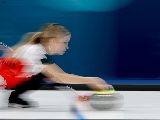 Canada's Kaitlyn Lawes throws a stone during a mixed doubles curling match against Olympic Athletes from Russia Anastasia Bryzgalova and Aleksandr Krushelnitckii at the 2018 Winter Olympics in Gangneung, South Korea, Saturday, Feb. 10, 2018. (AP Photo/Natacha Pisarenko)