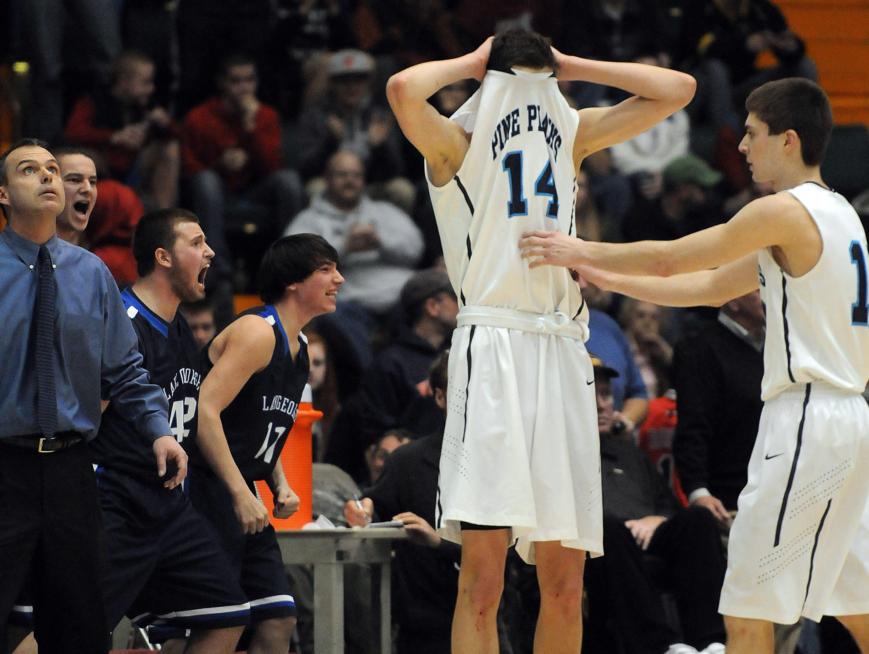 Pine Plains' Tyler Lydon, left, and Justin Cooper, react in the final minute of the game on March 16, 2013 as they trail Lake George in Glens Falls.