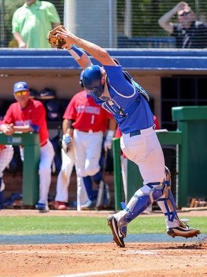UWF catcher Matt Sullivan (12) reaches back to catch a popup hit by West Georgia's Cade Marlowe on Jim Spooner Field at the University of West Florida on Saturday, March 31, 2018.