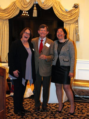 Hudson Highlands Land Trust Executive Director Andy Chmar receives Not-for-Profit Organization of the Year Award from Cold Spring Area Chamber of Commerce President Debbi Milner and Vice-President Alison Anthoine.