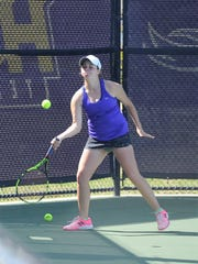 Wylie's Hailey Parker hits a shot during the girls