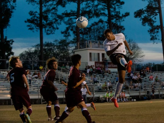 Alabama Christian's J.J. Williams (7) heads the ball in for a goal off of a corner kick during the match on Tuesday, March 17, 2015, in Montgomery, Ala.