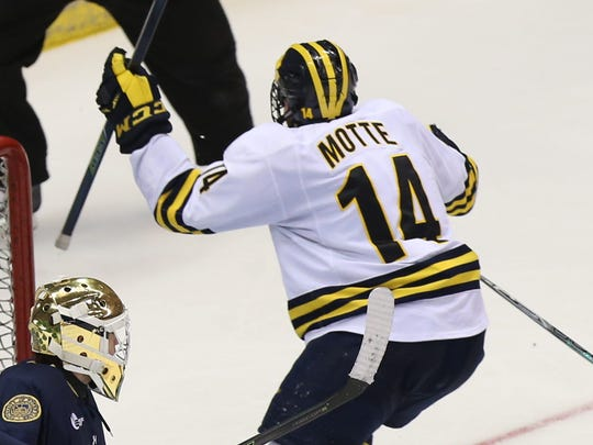 Michigan's Tyler Motte celebrates his game-winning goal Friday.