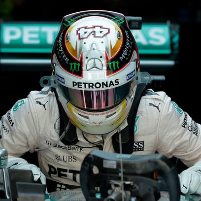 Mercedes driver Lewis Hamilton of Britain gets up from