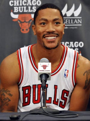 Bulls point guard Derrick Rose spoke to news reporters at media day in Deerfield, Ill., on Friday.