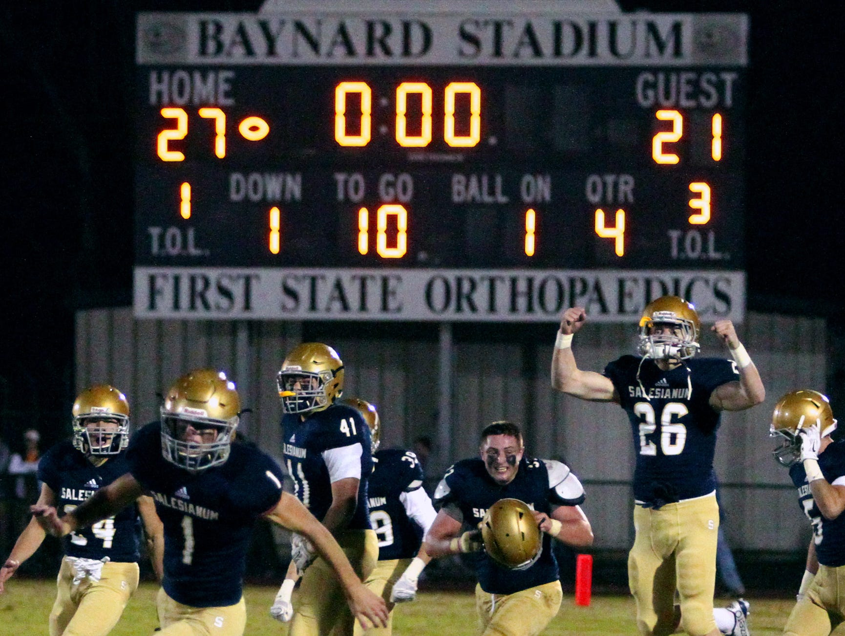 Salesianum celebrates its win against Middletown after the final play in a DIAA Division I state tournament semifinal at Baynard Stadium Friday.