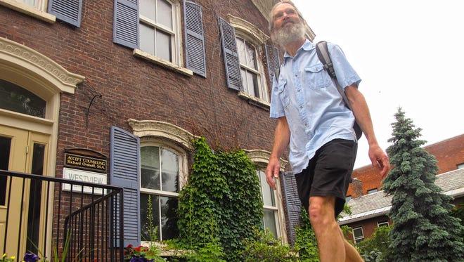 Michael Healy, 54, hits the sidewalk on College Street in Burlington earlier in the week. JOEL BANNER BAIRD/FREE PRESS
