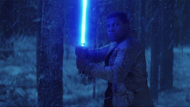 Finn (John Boyega) is ready for a fight in 'Star Wars: The Force Awakens.' Marcus Theatres will allow fans to bring lightsabers to showings at its theaters and also welcomes fans to come in costume.