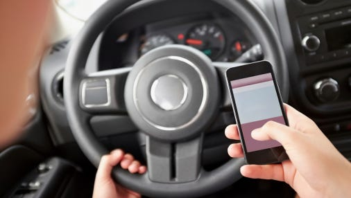 Person texting while driving.