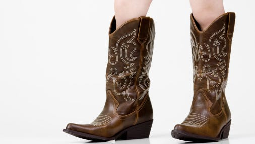 A toddler boy was discovered wandering around unattended wearing nothing but cowboy boots.