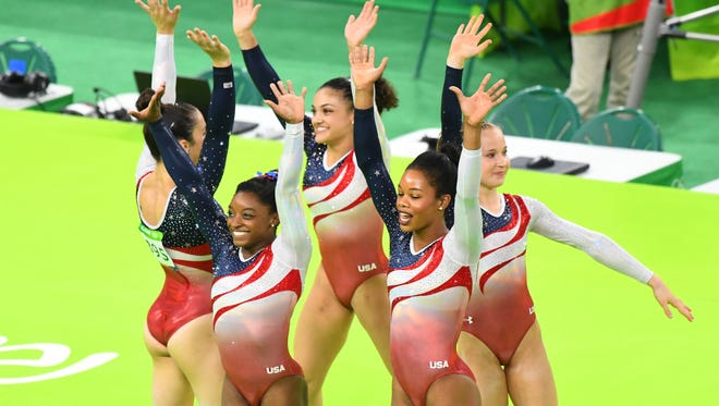 Team USA waves to fans during the women's team finals in the Rio 2016 Summer Olympic Games at Rio Olympic Arena.