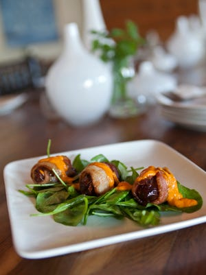 Tuck Shop restaurant in Phoenix prepares comfort foods perfect for entertaining. Pictured are bacon covered dates.