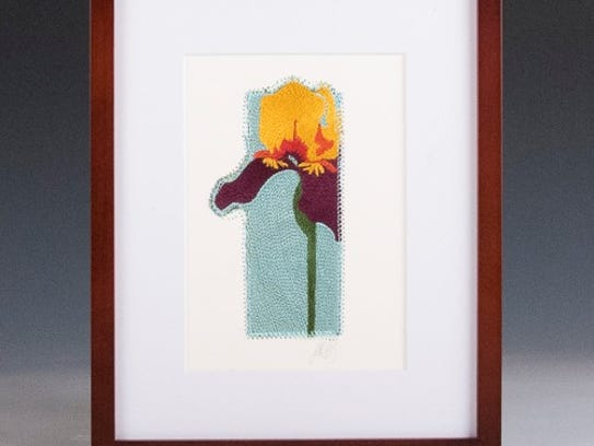 Embroidered art by Jean Corby, whose work is featured