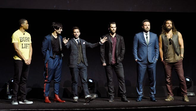 Zack Snyder, center, director of 'Justice League,' addresses the audience with cast members, from left, Ray Fisher, Ezra Miller, Henry Cavill and Ben Affleck during the Warner Bros. presentation at CinemaCon 2017.