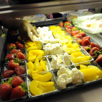 Fruit and vegetables are served during lunch at an elementary school.