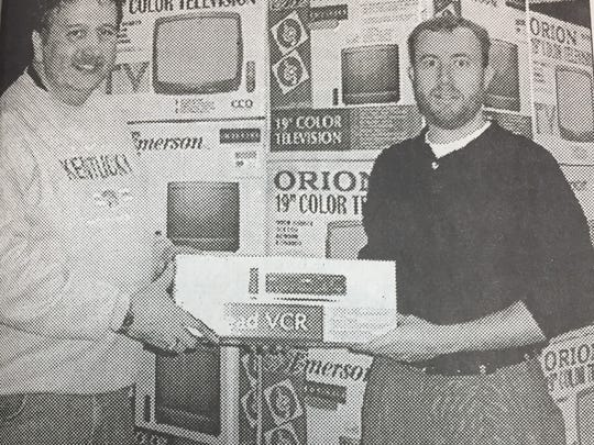 Larry Adamson of Morganfield, left, is shown with Hal Hedley at the Ronald McDonald House in Louisville. Adamson spearheaded a drive that resulted in the donation of 20 TV sets and 6 VCRs for the Ronald McDonald House in March 2002. Money for the TVs and VCRs was donated by Union County individuals and businesses.