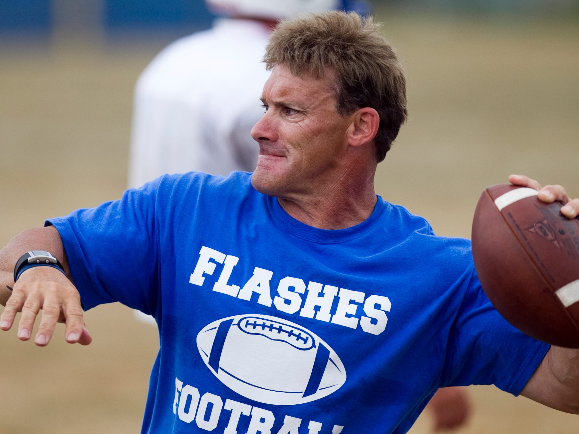 Burt Austin throws a ball to players at afternoon football practice at Franklin Central High School, Indianapolis, IN, Friday, August 5, 2011. Robert Scheer/The Star <b>08/18/2011 - S01 - SOUTHINDY - 1ST - THE INDIANAPOLIS STAR</b><br />