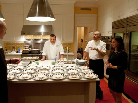 Celebrity Chef Giuseppe Tentori, second from right, leads dinner preparations Friday at the vintner dinner of Susan & Gary Garrabrant in Naples. The dinner was part of The Naples Winter Wine Festival.