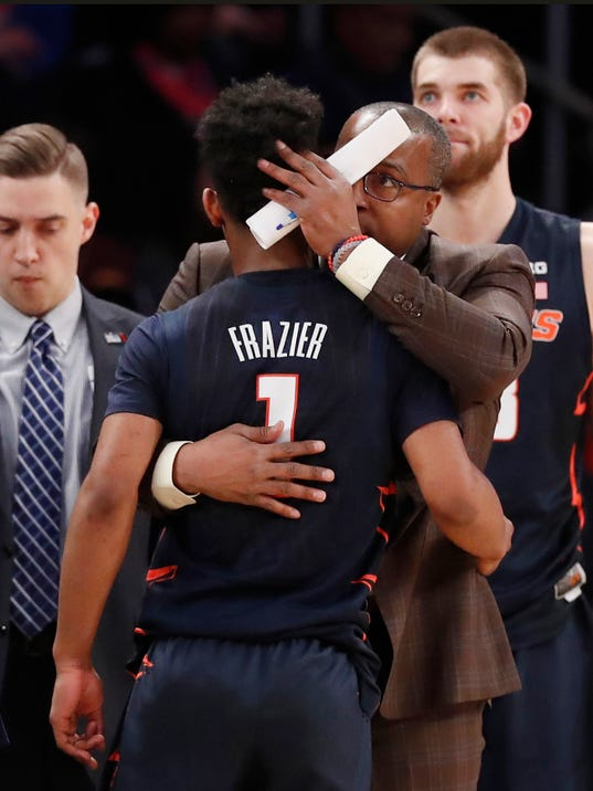 Illinois guard Trent Frazier (1) is consoled by an assistant coach after fouling out during the second half of the team's NCAA college basketball game against Iowa in the first round of the Big Ten men's tournament Wednesday, Feb. 28, 2018, in New York.Wednesday, Feb. 28, 2018 in New York. Iowa defeated Illinois 96-87. (AP Photo/Kathy Willens)