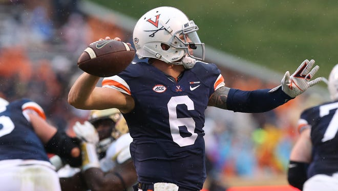 Virginia Cavaliers quarterback Kurt Benkert (6) passes the ball against the Georgia Tech Yellow Jackets first quarter at Scott Stadium on Saturday, Nov. 4, 2017, in Charlottesville.