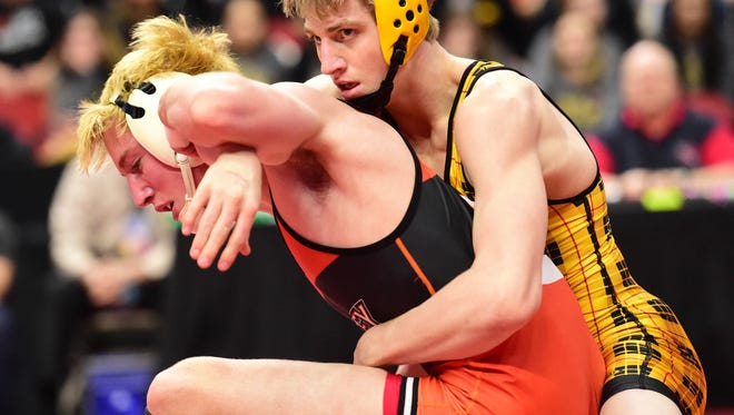 Southeast Polk's Zach Barnes looks to the referee for a scoring while wrestling Valley's Noah Carr Feb. 17 during the 3A State Dual Team finals at Wells Fargo Arena.