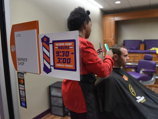 Haircare specialist Tyler Barton cuts Hunter Renfrow's hair in the barber shop inside Clemson's Allen N. Reeves Football Complex on Tuesday, September 29, 2017.