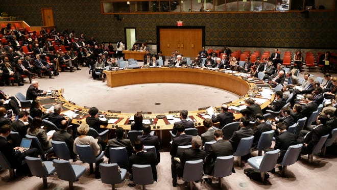 Members listen as Palestinian Ambassador to the United Nations Riyad Mansour, left, speaks during a meeting of the U.N. Security Council on Tuesday, Dec. 30, 2014.
