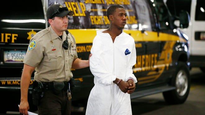 Jason Christopher Lindsey Jr. arrives at the Maricopa County Jail on Saturday, Feb.21, 2015 in Phoenix, Ariz.
