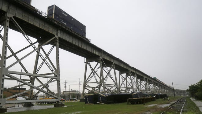 Train cars toppled off the Huey P. Long Bridge, which crosses over the Mississippi River, during high winds in Jefferson Parish, La., just outside New Orleans, on April 27, 2015.