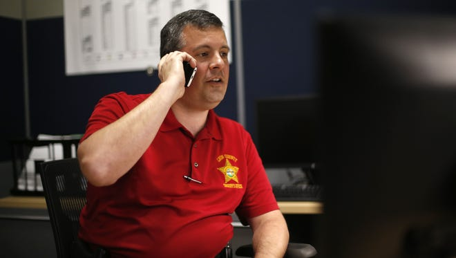 Leon County Lieutenant Tony Drzewiecki answers a call from his office at the CDA in 2015.