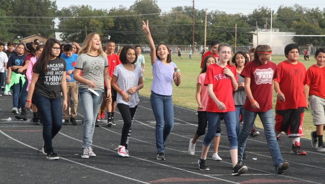 Carlsbad Intermediate School students walked on the school track for the Walk Out on Drugs walkathon on Friday.