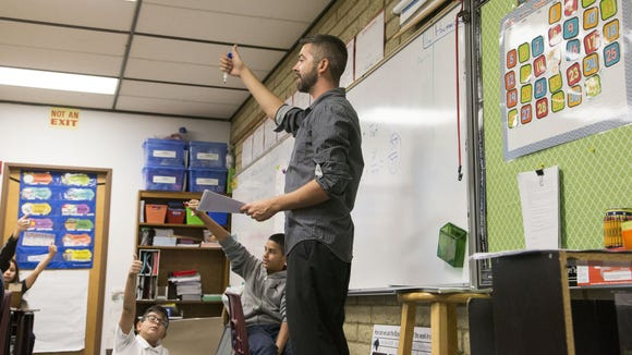 Tyler DeMoe, 27, teaches math to fifth-graders at Palm