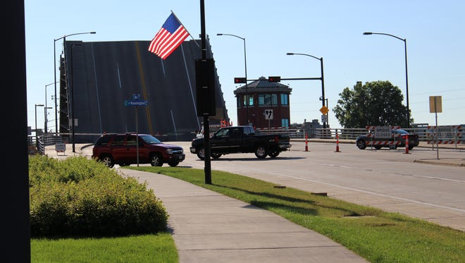 Main Street traffic in downtown Green Bay is detoured Sunday evening after a ship hit the Ray Nitschke Memorial Bridge at about 3:30 p.m.