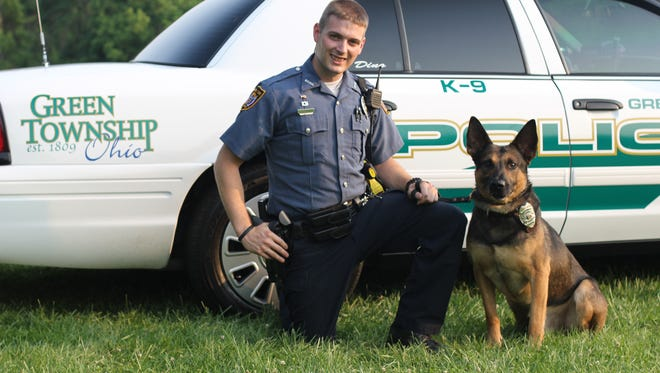 Cpl. Tony Leidenbor with the Green Township Police Department is shown with Dino, a police canine that died in September during a police search. Leidenbor is currently training a new K9 for the department.