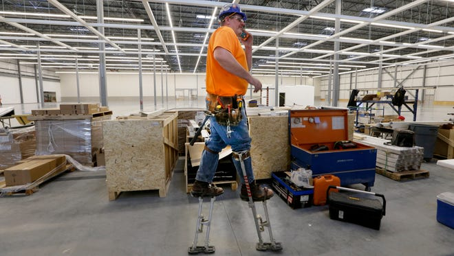 Doug Blank of Central Ceiling in Deerfield works Tuesday at the future Ikea store in Oak Creek. The 291,000-square-foot building on 29 acres along W. Drexel Ave. near I-94 will employ 250 people at its opening this summer.
