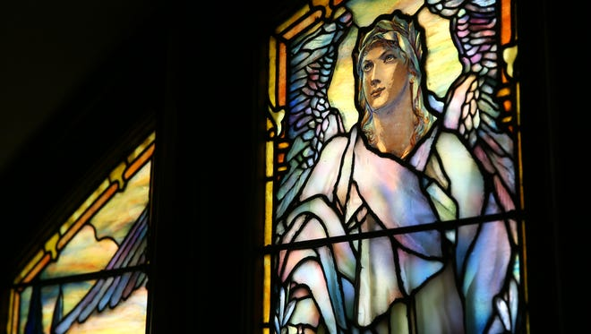 Detail view of The Angel of Resurrection stained glass window at The Church of the Advent in Walnut Hills, pictured, Monday, March 26, 2018. The church features stained glass by American artist Louis Tiffany. As in the Angel of Purity Window (4) there is the central Angel, but now white-robed, and without a biblical quote its usual concept as messenger of God may be assumed, according to the church.