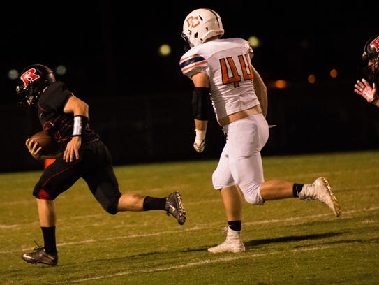 Gino Avros, 12, runs in for a touchdown as Dylan Dooley,