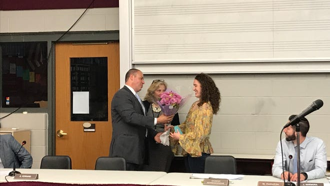 Nutley Board of Education President Daniel Carnicella and Schools Superintendent Julie Glazer offer best wishes to outgoing student representative Katerina Robles on June 19, 2017.