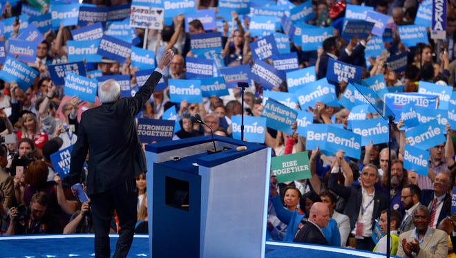 Sen. Bernie Sanders waves to supporters during the first day of the Democratic National Convention in Philadelphia late Monday.