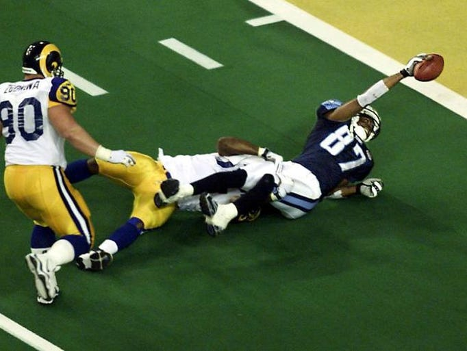 Tennessee's Kevin Dyson stretches for the goal in the last play of Super Bowl XXXVI. The Rams won 23-16.