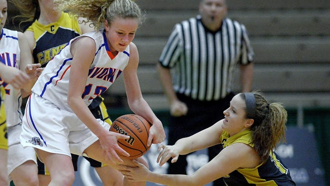 Livonia's Molly Stewart, left, wrestles the ball away form Canton's Katelyn Flanaganduring a Class B semifinal at the 2016 NYSPHSAA Girls Basketball Championships held at Hudson Valley Community College in Troy, N.Y. on Friday, March 11, 2016. Livonia advanced to Saturday's Class B championship game with a 50-41 win over Canton-X.