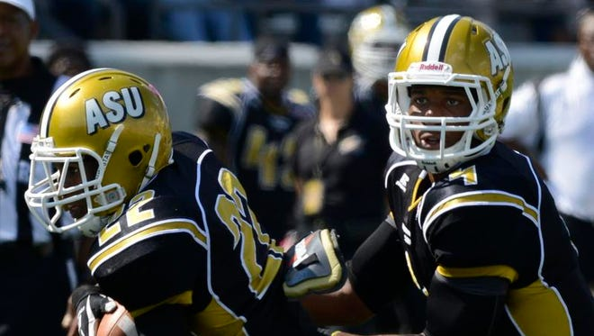 ASU's Malcolm Cyrus, left, (22) takes the hand off from Arsenio Favor (4) during their game with Prairie View at Hornet Stadium on Saturday, Oct. 12, 2013, in Montgomery, Ala.