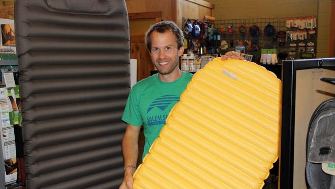 Al Tandy shows off a sleeping pad that his business, Salem Summit Company, sells.
