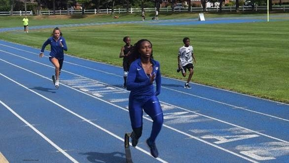 Brockton High graduate Femita Ayanbeku, in the foreground, and teammate Noelle Lambert, in background, training the outdoor at Milton Academy.