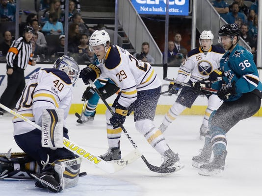 Buffalo Sabres goalie Robin Lehner (40) stops a shot next to teammate Jake McCabe (29) and San Jose Sharks' Jannik Hansen (36) during the second period of an NHL hockey game Tuesday, March 14, 2017, in San Jose, Calif. (AP Photo/Marcio Jose Sanchez)