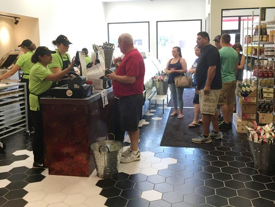 Customers line up at Elroy's Deli Market, which opened