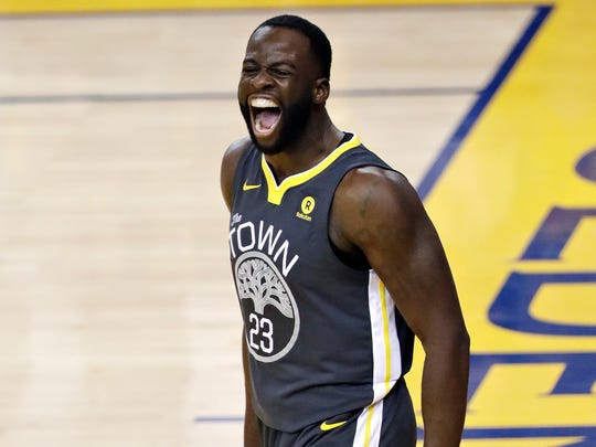Draymond Green celebrates after scoring against the Cavaliers during Game 2 of the 2018 NBA Finals on June 3.